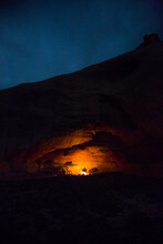 Female Cooks Dinner In A Cave In Rabbit Valley, Colorado After A Long Mountain Bike Ride Through The Desert.