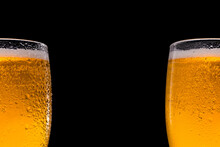 Two Beer Glasses Beer On Black Background. Space For Text And Logo