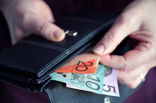 Woman Hand Pulling Out Australian Money From A Wallet