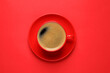 Leinwandbild Motiv Cup of aromatic coffee on red background, top view