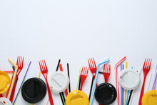 Plastic Dishware On White Background, Flat Lay. Space For Text