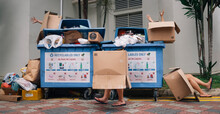 Boxes With Hands And Legs At Recycling Bins In Singapore HDB Estate