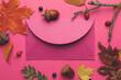 Leinwandbild Motiv Envelope and autumn leaves on color background