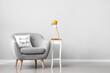 Leinwandbild Motiv Interior of modern room with armchair and lamp