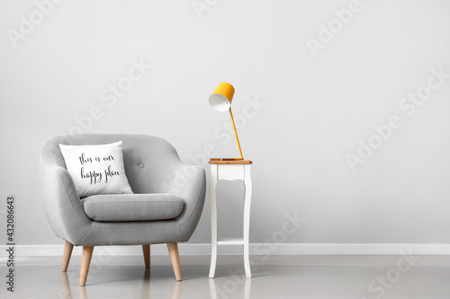 Fototapeta Interior of modern room with armchair and lamp obraz