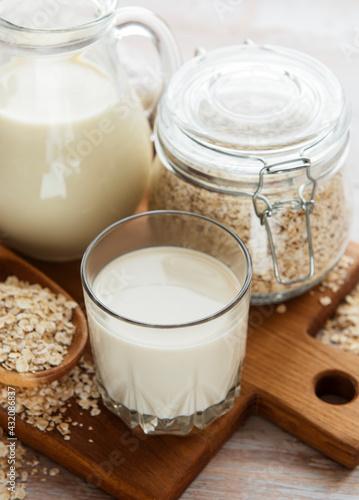 Obraz Vegan oat milk, non dairy alternative milk - fototapety do salonu
