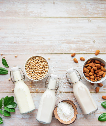 Obraz Bottles with different vegetable milk - fototapety do salonu
