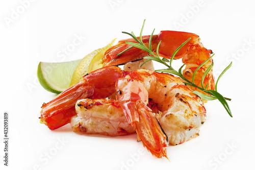 Fototapeta Grilled prawn tails with lemon, lime, rosemary on white obraz