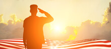 Soldier And USA Flag On Sunrise Background .Concept National Holidays , Flag Day, Veterans Day, Memorial Day, Independence Day, Patriot Day.