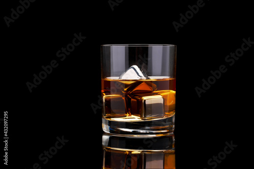 Obraz Whiskey with steel cooling cubes on dark glass background - fototapety do salonu