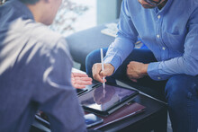 Businessman Got A Digital Pencil To Puts Signature On Digital Contract At Business Meeting After Negotiations With Business Partners. Selected Focus