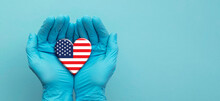 Doctors Hands Wearing Surgical Gloves Holding USA Flag Heart