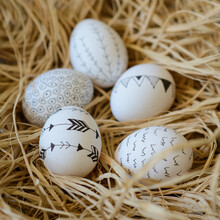 Close-up Of Five Decorated Easter Eggs In A Bird's Nest