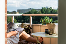 Women Reading On Her Balcony A Sunny Day