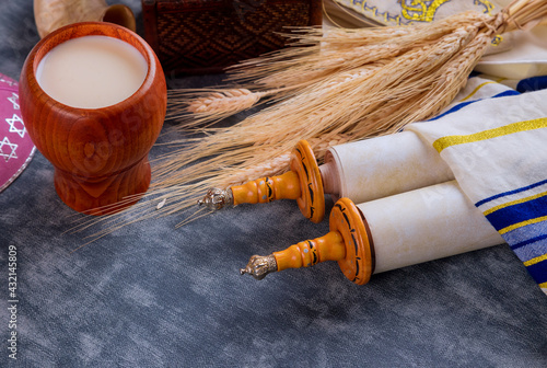 Fototapeta Torah and tallis in the Traditional celebration season Jewish holiday Shavuot on kosher dairy food obraz