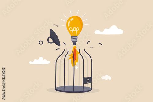 Fotografie, Tablou Unleash creativity or unlock business idea to grow beyond limitation concept, lightbulb creative idea breaking birdcage with launching  rocket booster