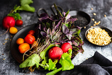Bunch Of Purple Basil, Tomatoes And Radishes On A Plate With Black Sesame Seeds And Sunflower Seeds