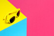 Leinwandbild Motiv yellow plastic sunglasses