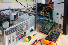Repairing Computers. Open Tower PC With Multimeter