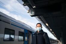 Woman Wearing Face Mask On Train Station Platform