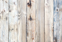 Texture Of The Planks Of An Old Wooden Table In Antiqued Light Pastel Colors. Vintage Rustic Wooden Background. Carpentry.