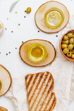 Overhead View Of A Slice Of Ciabatta Toast With Green Olives, Olive Oil And Fresh Garlic