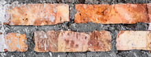 Vintage Textured Background Of Red Brick Wall. Old Brick Wall With Cracks And Scratches. Horizontal Wide Brick Wall Background. Distressed Wall With Broken Bricks Texture. Vintage House Facade.