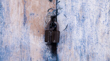 Background Of Very Old Metal Rusty Grey Garage Door With Handle And Barn Lock