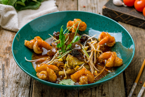 Fried shrimps in sweet spicy sauce with vegetables, royal shrimps, chinese cuisine