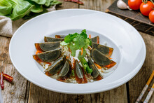Black Egg Imperial Chinese Cuisine On Old Wooden Table