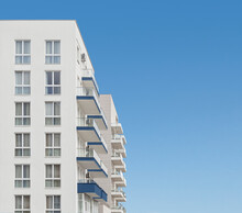 Apartment Residential House Or Block Of Flats With Balconies At Clear Blue Sky Background