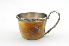 Old Copper Cup On A White Background