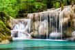 Waterfall and blue emerald water color in Erawan national park. Erawan Waterfall, Beautiful nature rock waterfall steps in tropical rainforest at Kanchanaburi province, Thailand