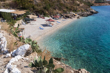 Small Picturesque Beach And Clear Turquoise Water In Porto Palermo, Albania. View From Above. Travel Theme, Beautiful Nature