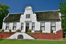 Historic Building On The Rustenberg Estate. Most Of The Buildings Are In The Traditional Cape Dutch Style, With Beautiful Gables And Homely Thatch Roofs. Republic Of South  Africa.