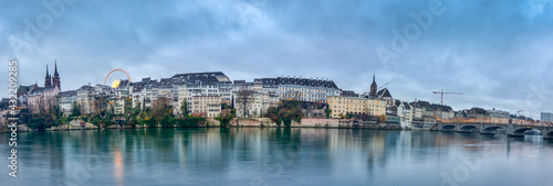 Fototapeta Wide view of the Switzerland promenade of the city of Basel with buildings from