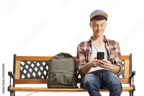 Guy sitting on a bench and using a mobile phone