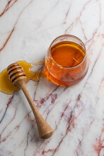 Honey In Glass Jar With Dipper