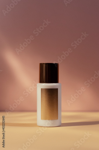 Obraz white cream tube with gold cap isolated on pink blurred background, cosmetics mock up, skin care, body lotion - fototapety do salonu