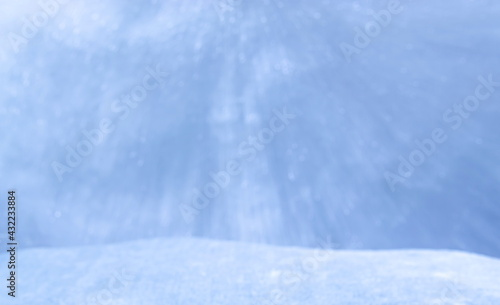 Fotografie, Obraz A Bokeh Product Display Shelf, Showing Falling Orbs of Circular Light onto a Blurred Snow Stage for a Seasonal Scene