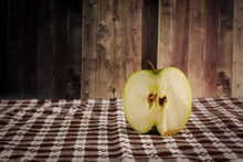 Half Green Apple On Rustic Wooden Background.
