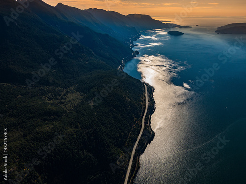 Fototapeta Stock aerial photo of a dramatic view of the Sea to Sky Highway and Howe Sound near Squamish, Canada obraz
