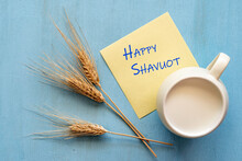 Happy Shavuot. Greeting Card Happy Shavuot Jewish Holiday, Wheat Ears, Milk Cup. Concept Of Happy Shavuot.