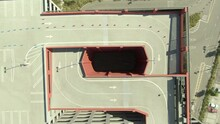 Aerial Top View Of Parking Garage In City On Sunny Day, Drone Ascending Over Structure - Los Angeles, California