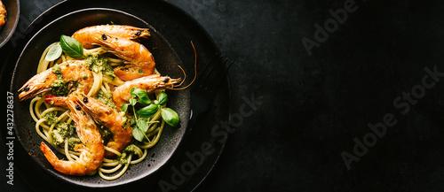 Fotografie, Obraz Spaghetti with pesto and prawns served on plate