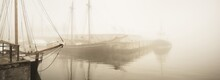 Elegant And Modern Yachts, Sailing And Fishing Boats Moored Ti A Pier In A Fog. Schooner Close-up. Landmarks, Sightseeing, Old Harbor, History, Past. Sepia Image Effect. Germaniahafen, Kiel, Germany