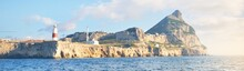 Trinity Lighthouse At The Rocky Shore (cliffs) Of The Europa Point. British Overseas Territory Of Gibraltar, Mediterranean Sea.A View From The Yacht. National Landmark, Sightseeing, Travel Destination