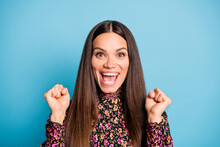 Portrait Of Young Happy Excited Delighted Positive Good Mood Woman Smiling Hold Fists In Victory Isolated On Blue Color Background