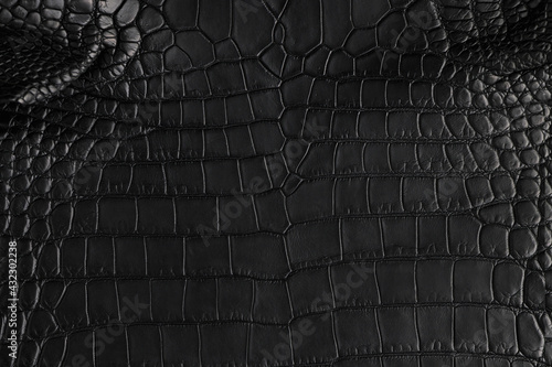 Foto Abstract background of seamless crocodile black leather texture