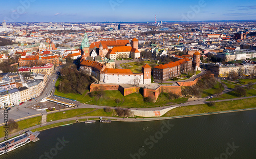 Canvas Print Aerial view of Wawel Hill with fortified Castle complex and belfry of Cathedral of Saints Stanislaus and Wenceslaus on sunny spring day, Krakow, Poland